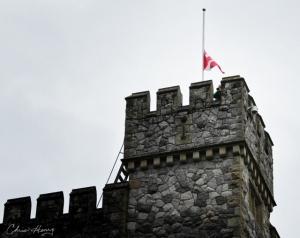 Trumpeter and flag at half mast: Christine Henry Arts Photo